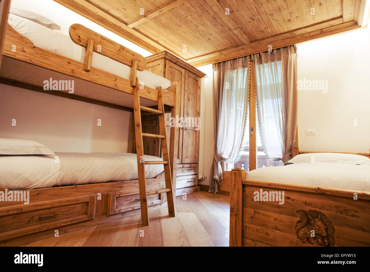 Triple Room With Single And Bunk Beds In A Childrens Bedroom