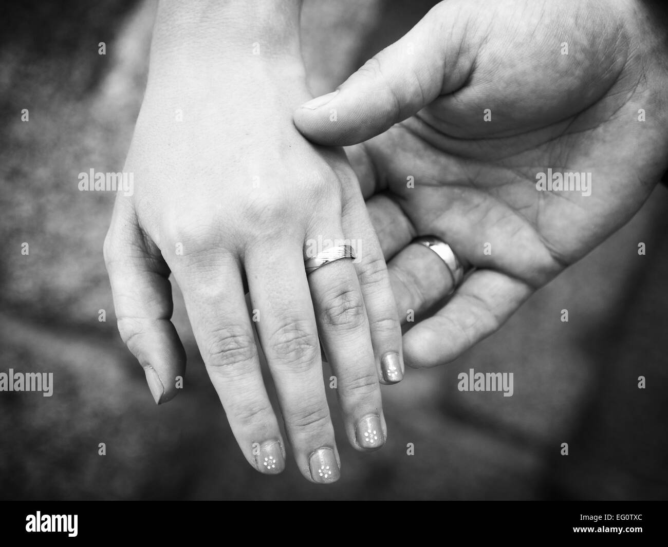still life two hands with wedding rings stock photo