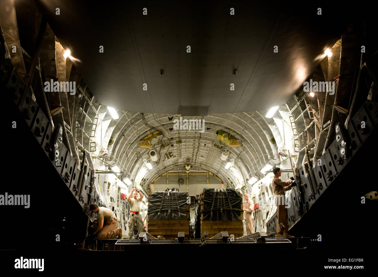 Us Air Force Loadmasters With The 816th Expeditionary Airlift Squadron,  Configure A C17 Globemaster Iii For An Airdrop While A Us Army Joint  Airdrop