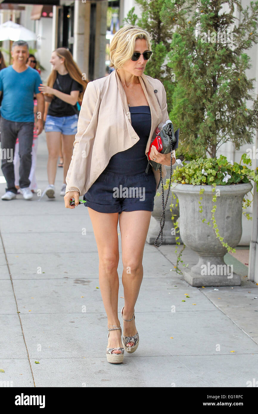 Elsa Pataky In A Navy Blue Strapless Top And Matching Shorts, Goes ...