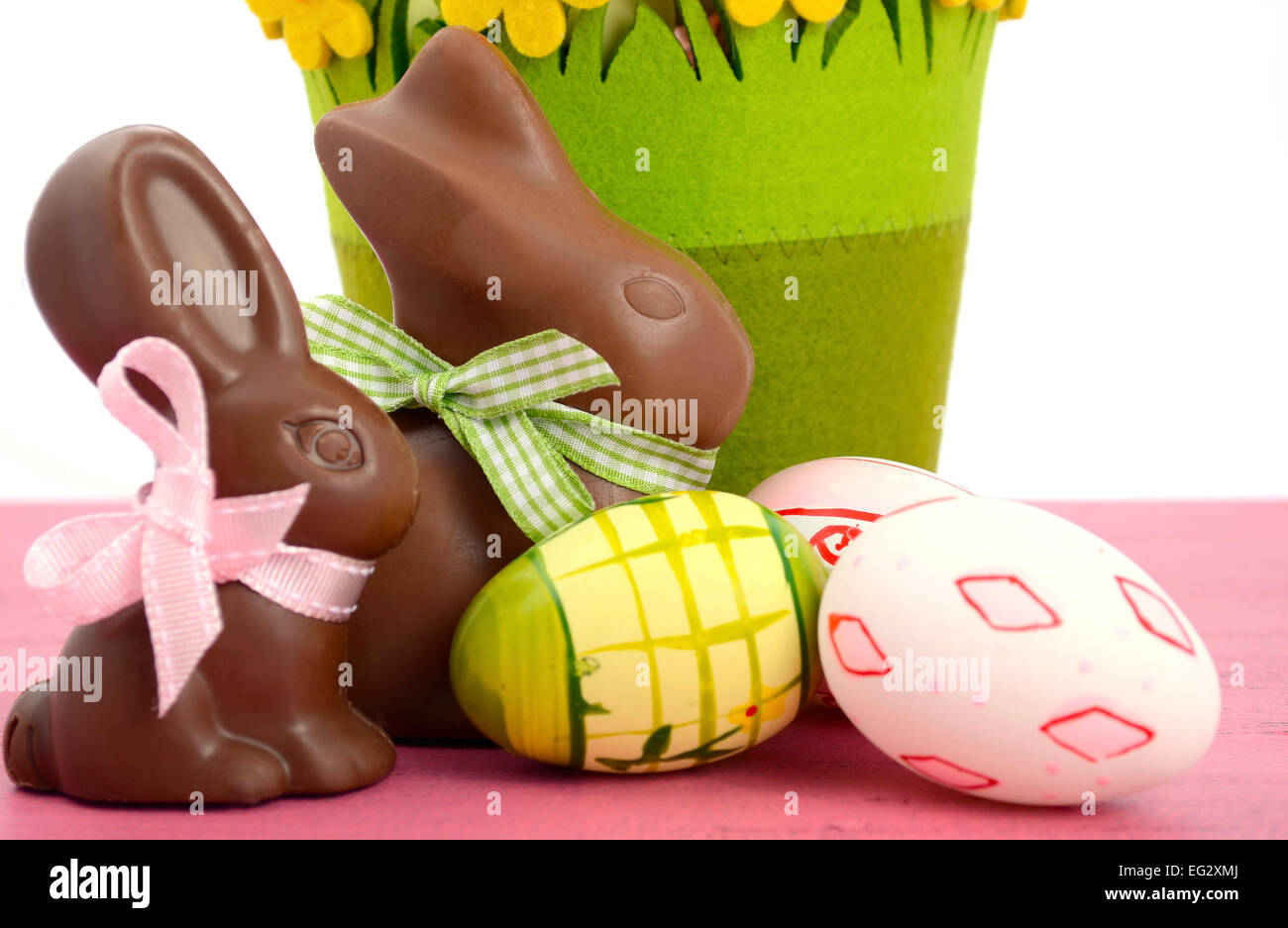 happy easter chocolate bunny rabbits with basket of pink white