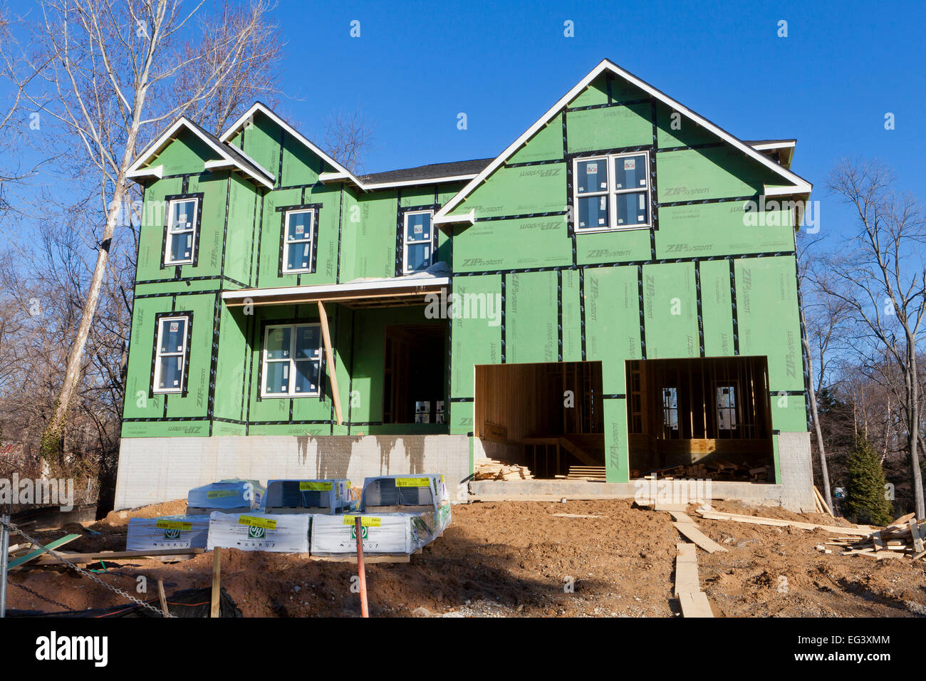 New house with zip sheathing and stretch tape house wrap for Sheathing house wrap
