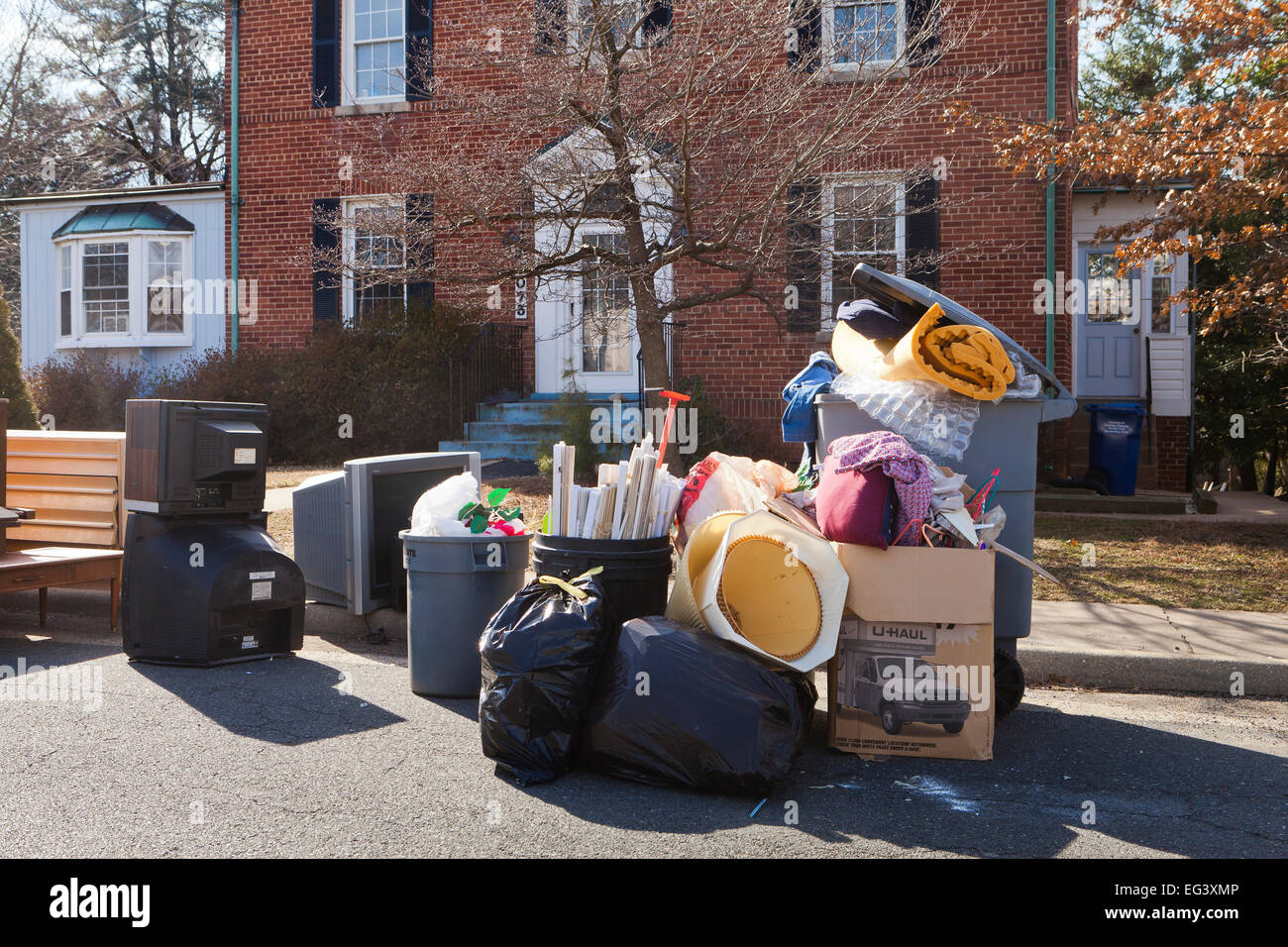 Furniture Piled Outside Of House After Eviction Of Tenant