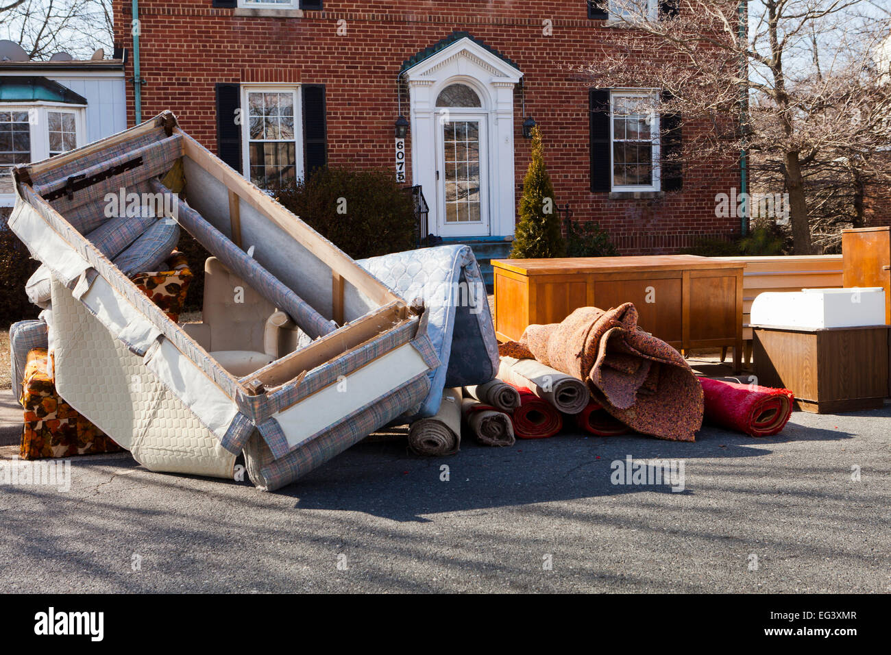 Furniture piled outside of house after eviction of tenant   Virginia USA. Furniture piled outside of house after eviction of tenant