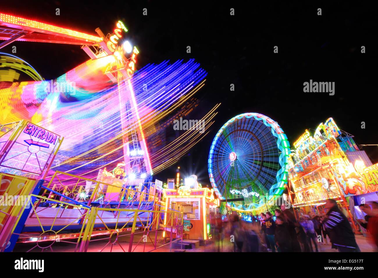 carousel and color games in amusement park at night stock photo