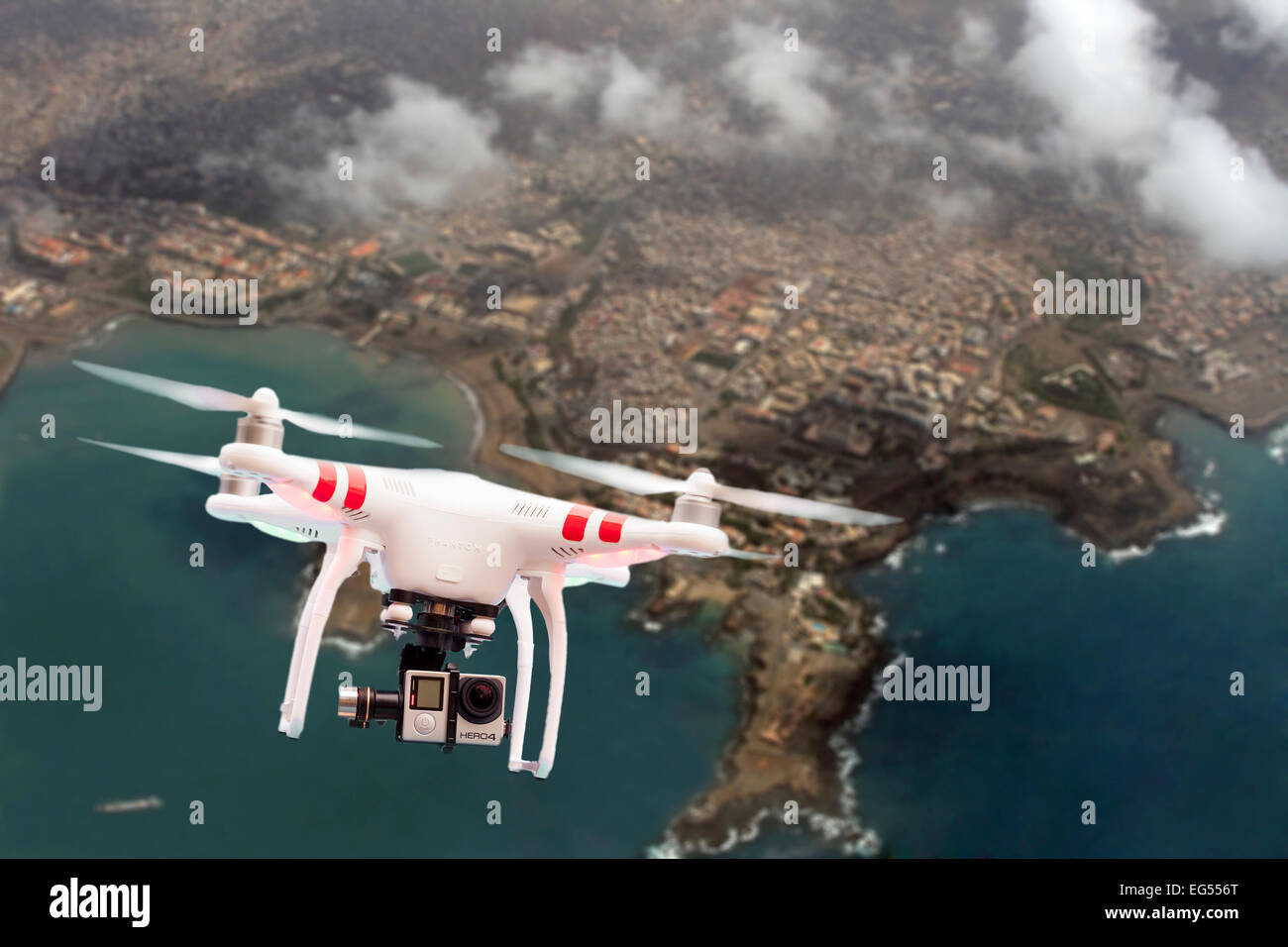 Non Military Quadcopter Or Drone Flying Over A Coastal Town