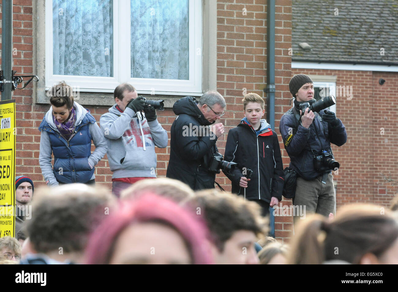 Ashbourne derbyshire uk 17th february 2015 local local photographers try to get a high viewpoint for the royal shrovetide football match between the downards and upards at junglespirit Image collections