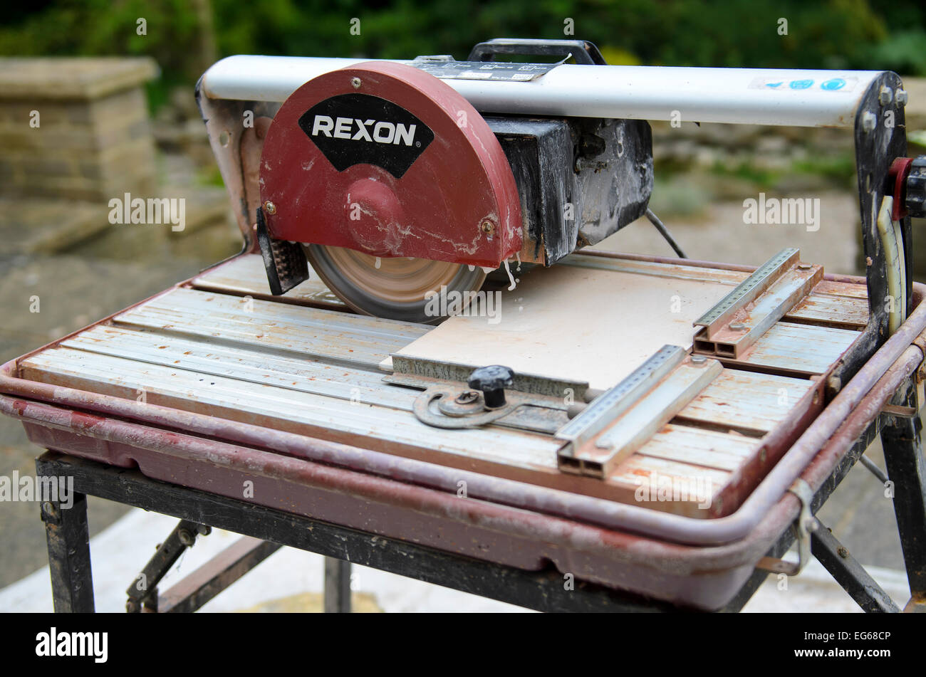Electric tile cutter stock photos electric tile cutter stock water cooled ceramic tile cutting machine stock image dailygadgetfo Gallery