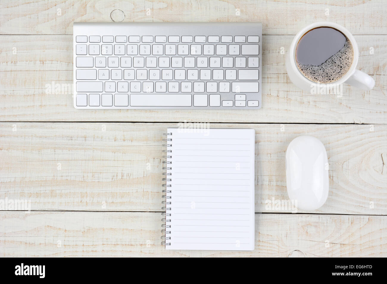 overhead shot of a rustic white wood desk with keyboard mouse  - overhead shot of a rustic white wood desk with keyboard mouse note pad