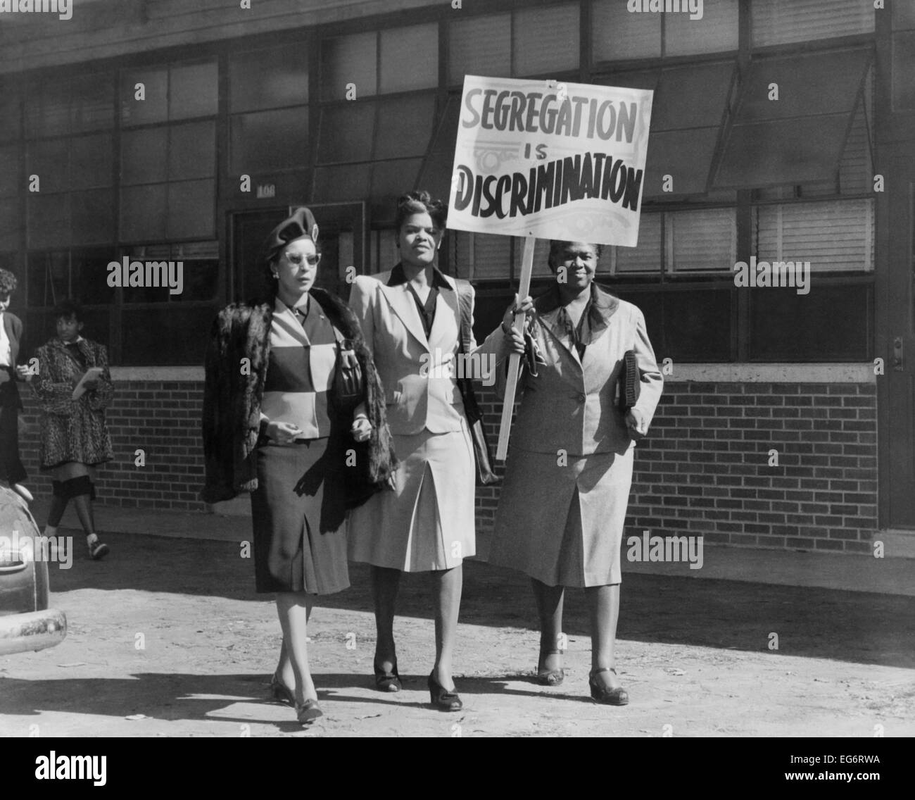 Three African American women with sign reading, 'Segregation is ...