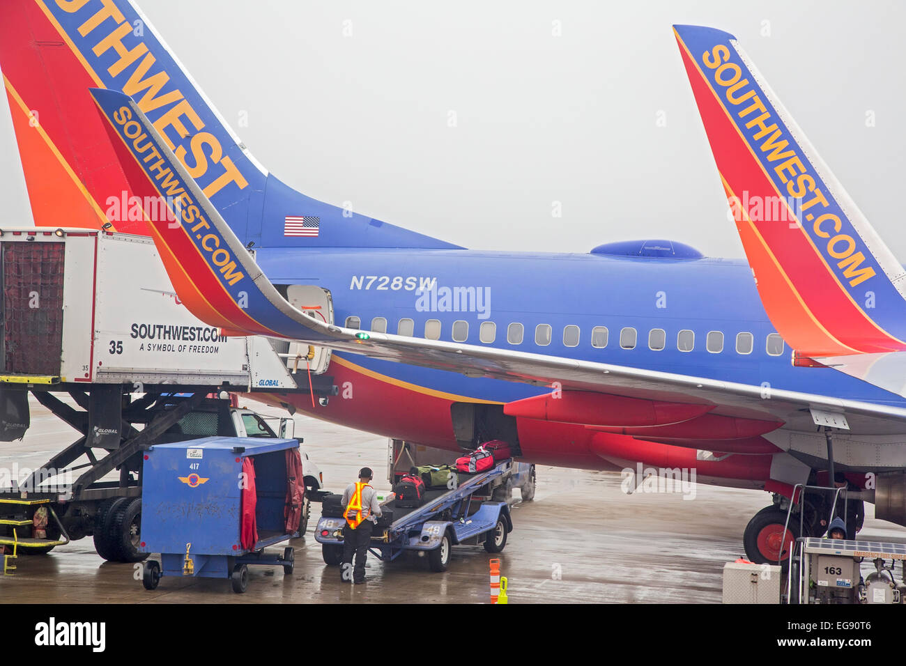 Chicago illinois a member of the southwest airlines ground crew chicago illinois a member of the southwest airlines ground crew at midway airport unloads luggage from a boeing 737 buycottarizona
