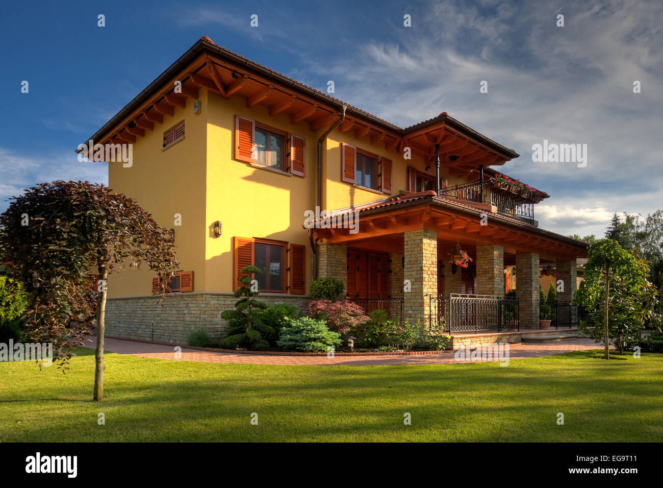 Big family home with green gras and blue sky stock photo for Big family house