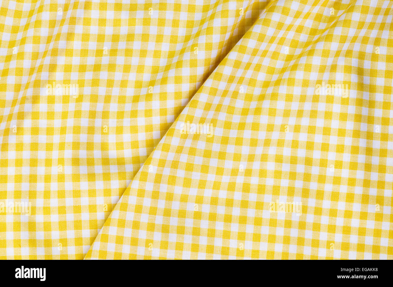 Stock Photo   Background Of Yellow Checkered Fabric Tablecloth