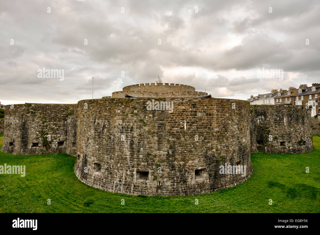 England deal castle outer walls and moat with keep in castle outer walls and moat with keep in background under grey cloudy sky hdr realistic altavistaventures Gallery