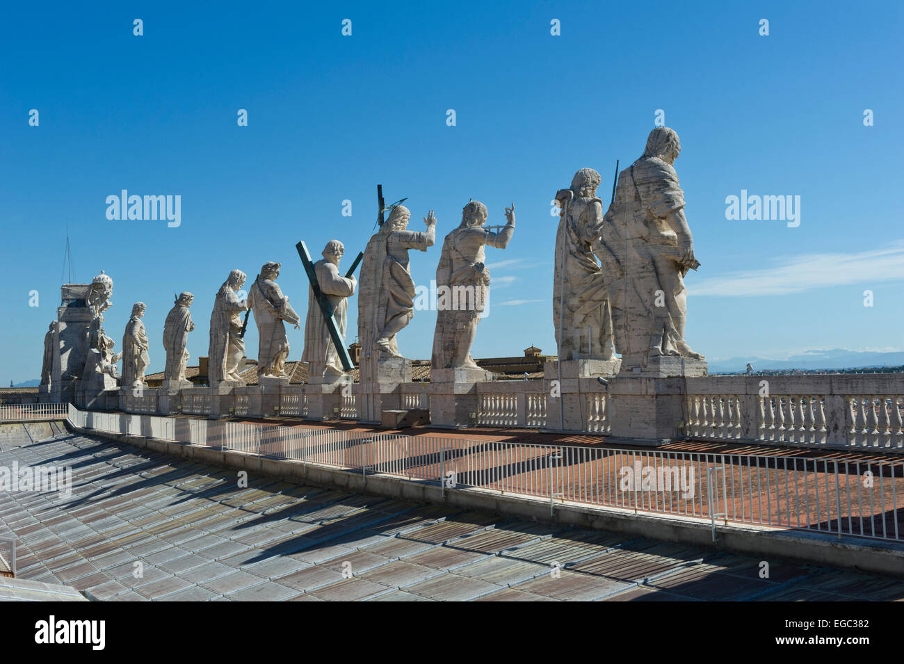a row of statues of jesus and his disciples on the rooftop of st