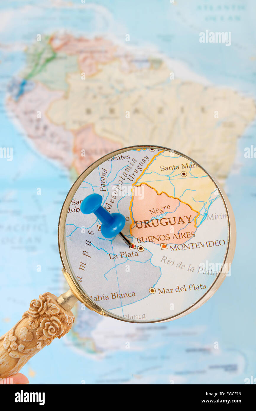 Blue Tack On Map Of South America With Magnifying Glass Looking In - Argentina globe map
