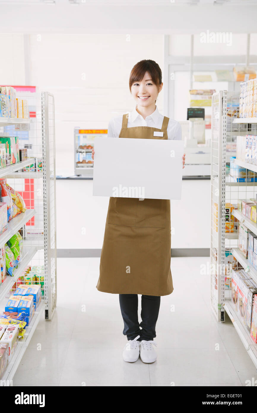 young ese convenience store female worker white board stock photo young ese convenience store female worker white board