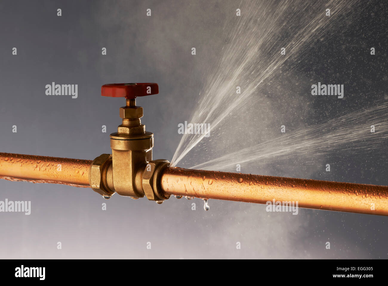 Steam Leak From Pipe : Plumbing burst leaking pipe with tap stock photo royalty