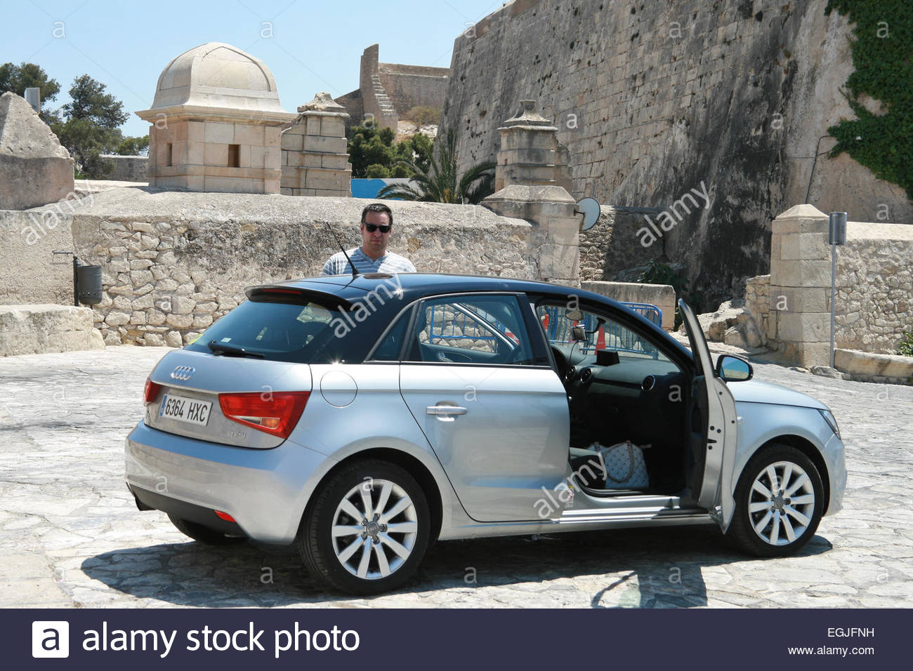 Audi Car With The Door Open And The Driver Stock Photo Royalty - Audi car and driver