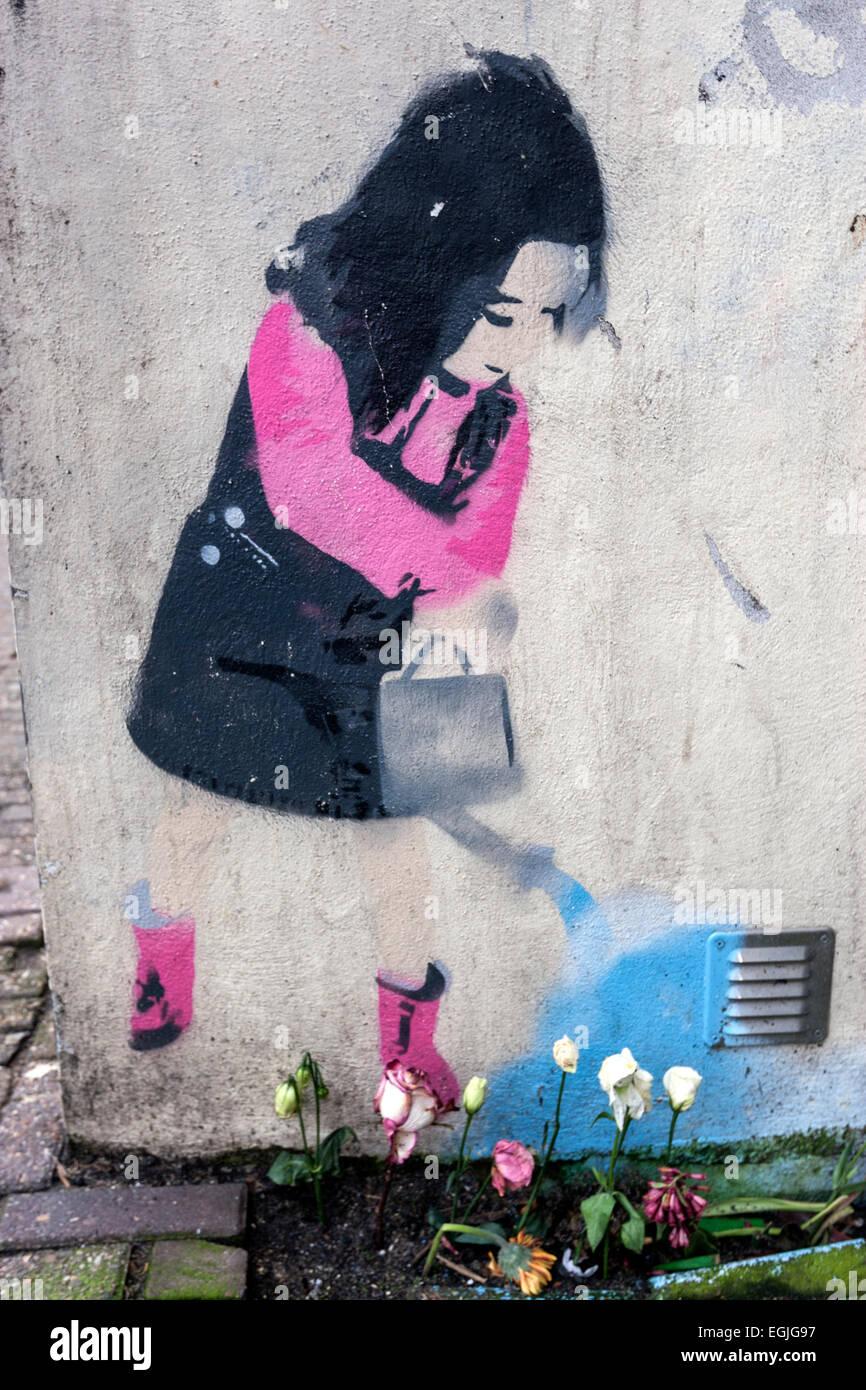 Graffiti wall amsterdam - Amsterdam Graffiti Of A Girl Watering Plants Street Art By Karma Stock Image