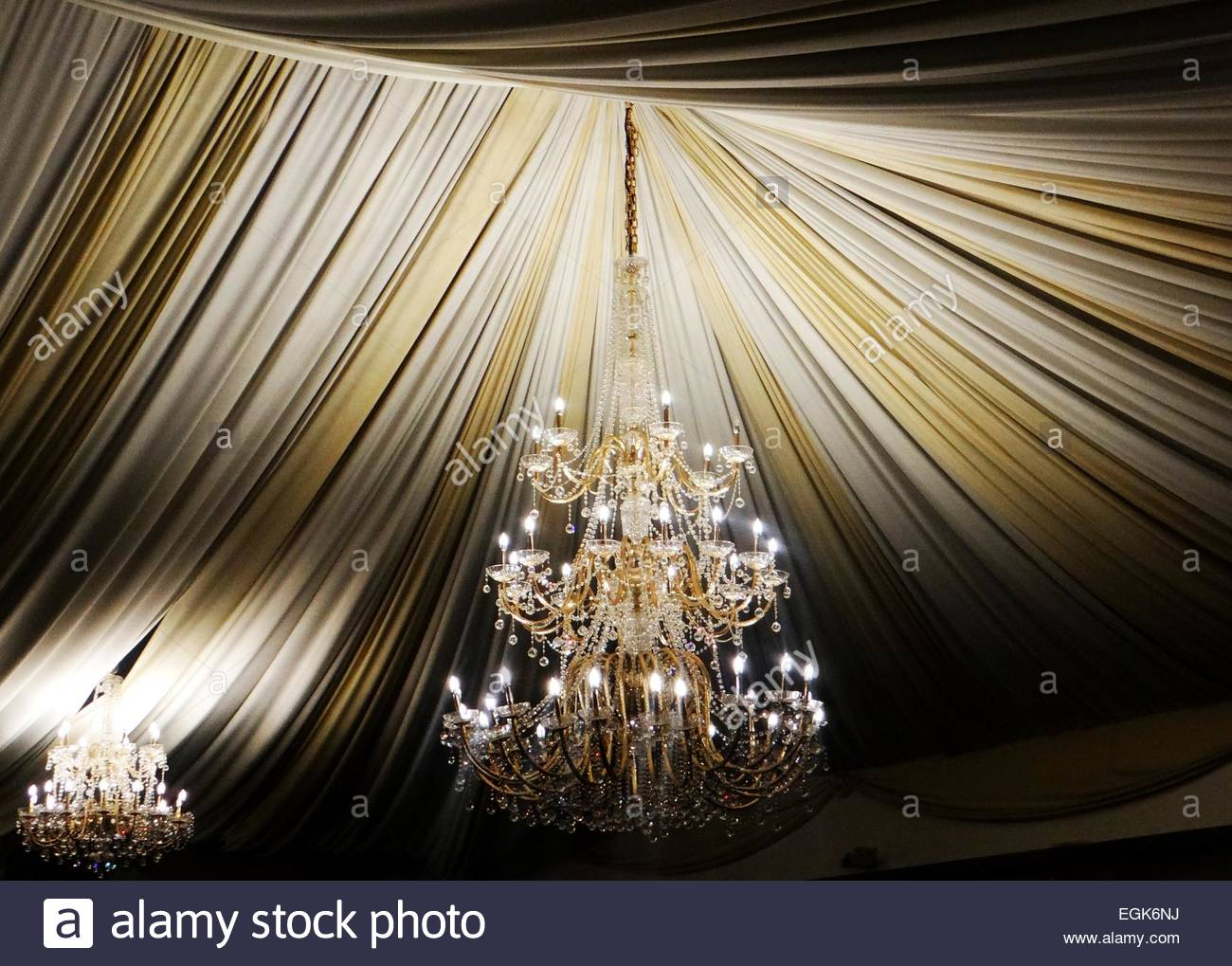 Ornate chandelier under ceiling decorated with hanging clothes stock ornate chandelier under ceiling decorated with hanging clothes aloadofball Choice Image