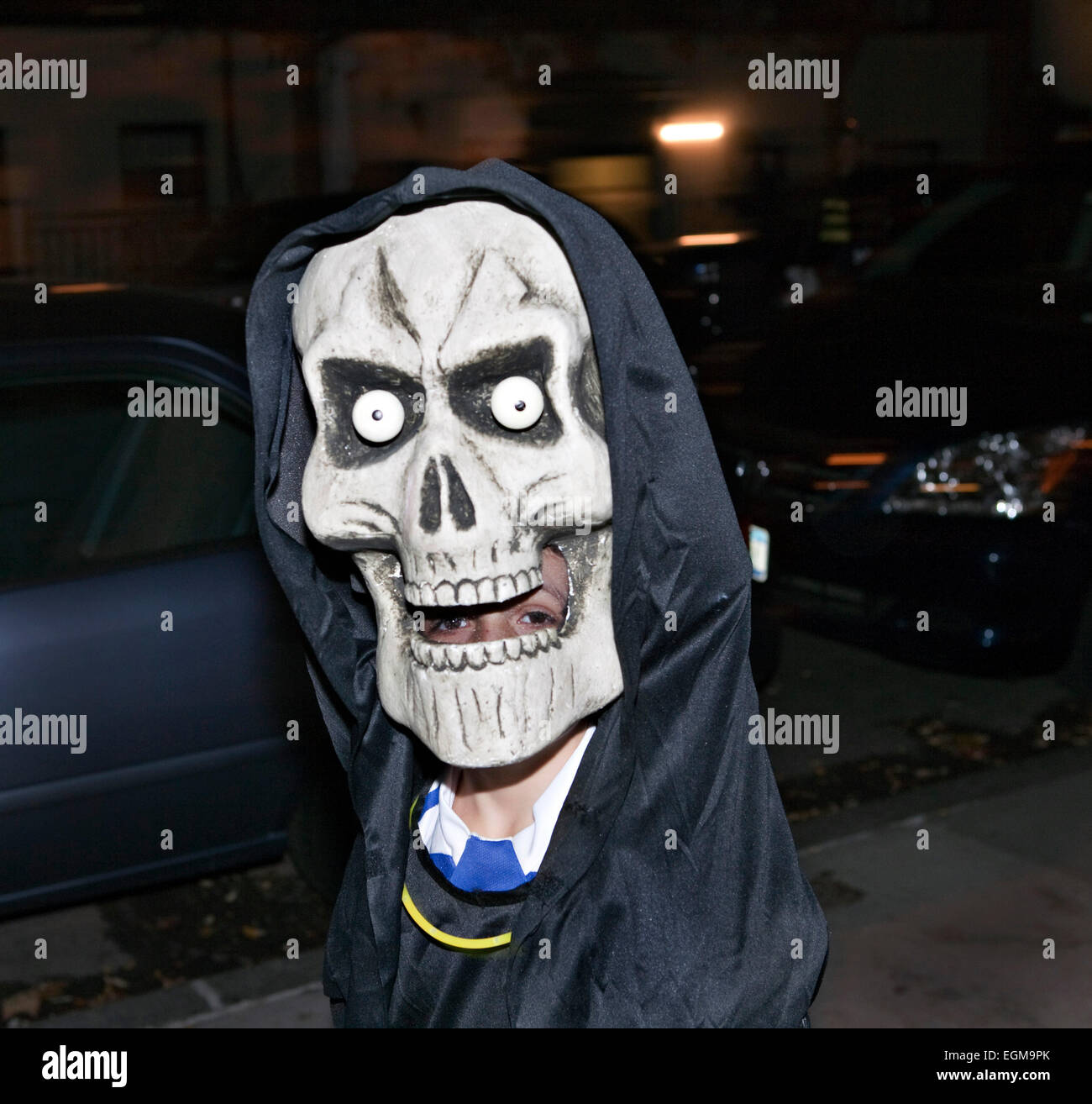 Giant Skull mask Trick or Treating Halloween Night Stock Photo ...