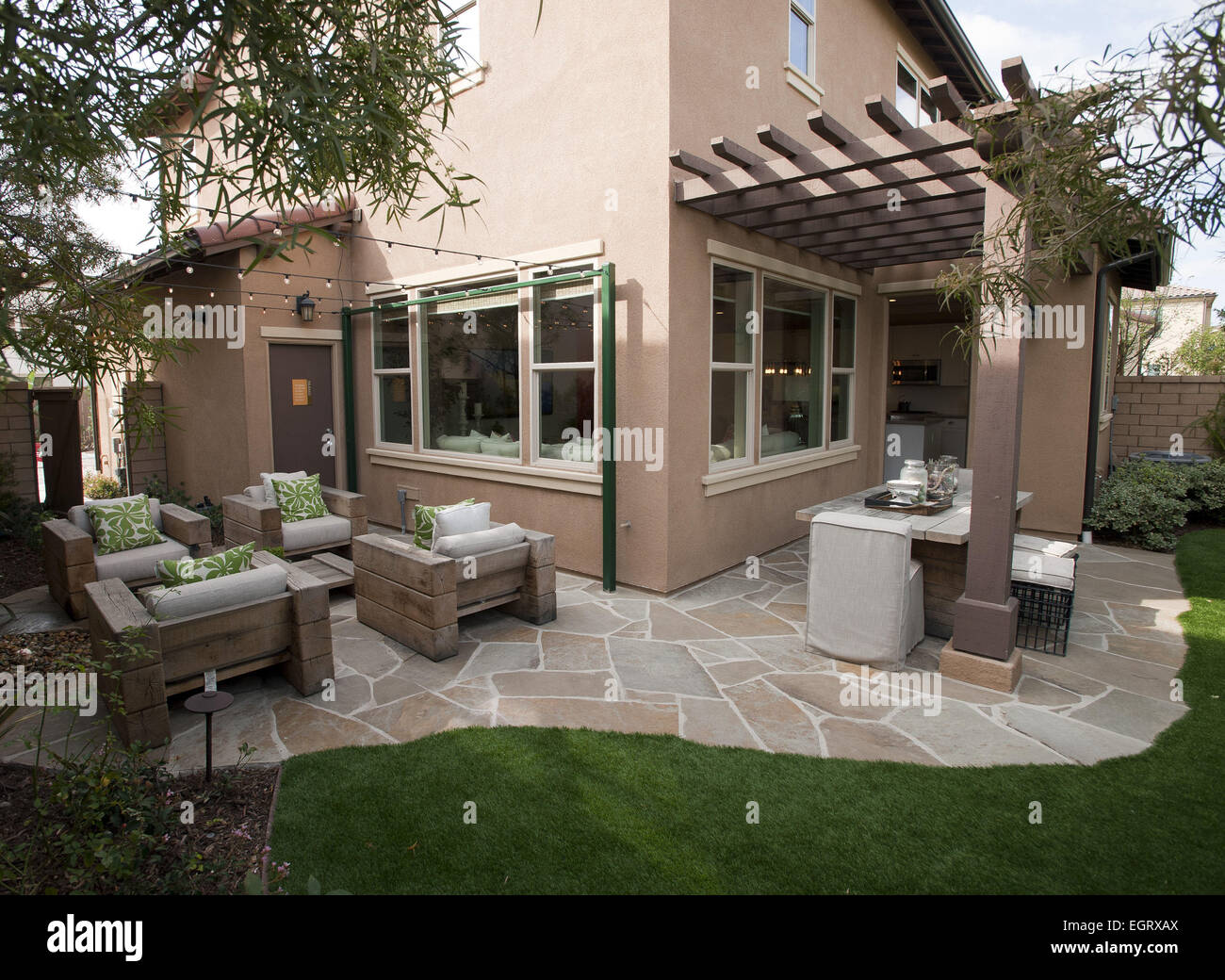 California Model Home Open And On Display For Home Shoppers To View. Model  Home Rear Patio Area With Seating And Outdoor