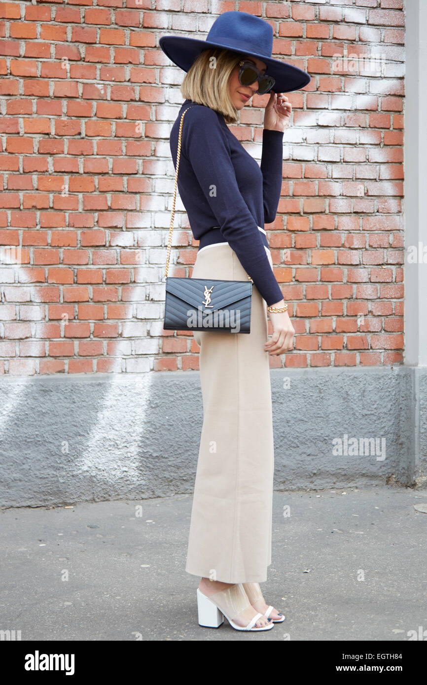 Woman Poses For Photographers Before Fendi Show With Yves Saint ...