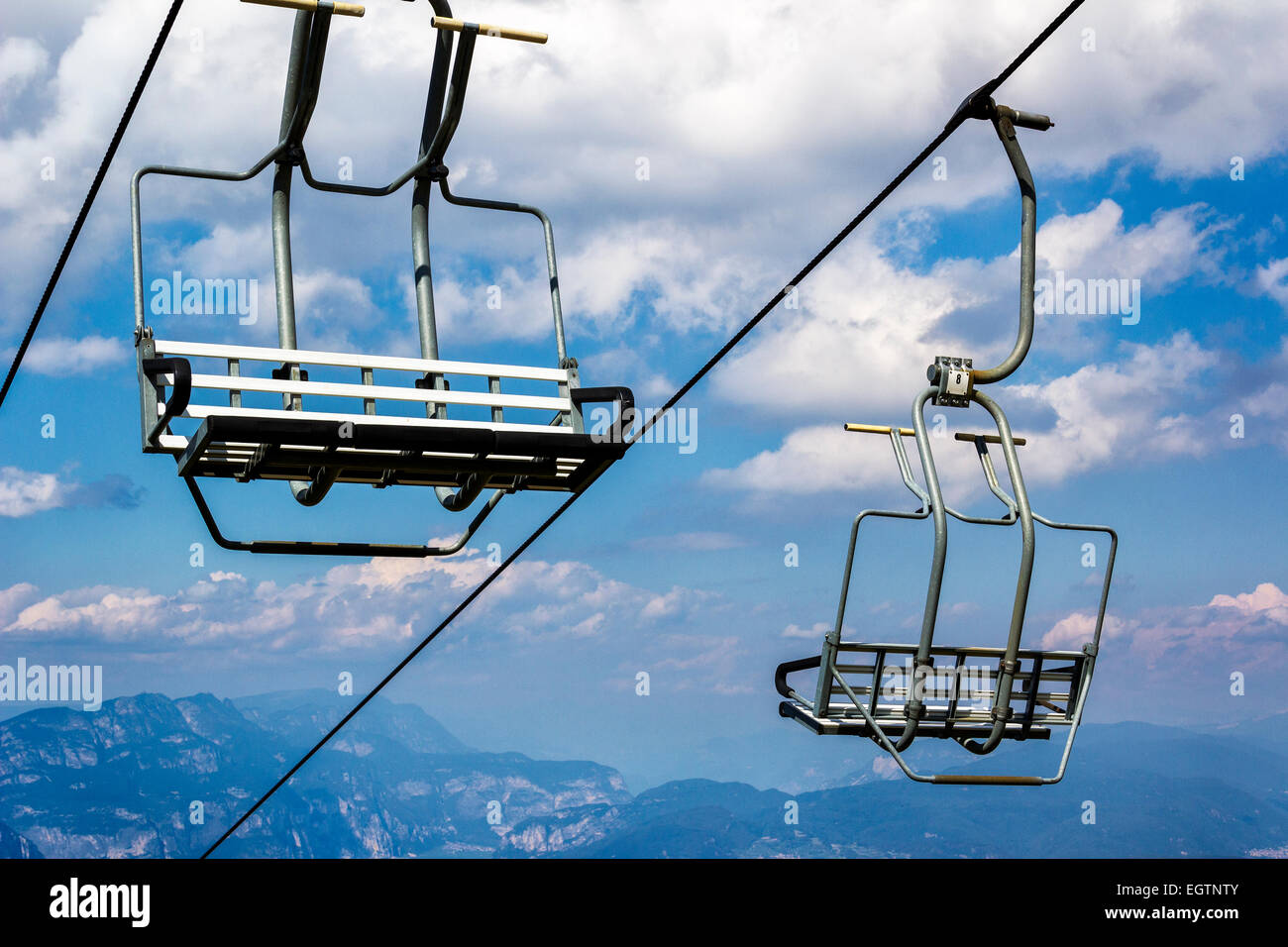 Sky Lift Seats on a Cloudy Sky in Italy Stock Photo, Royalty Free ...