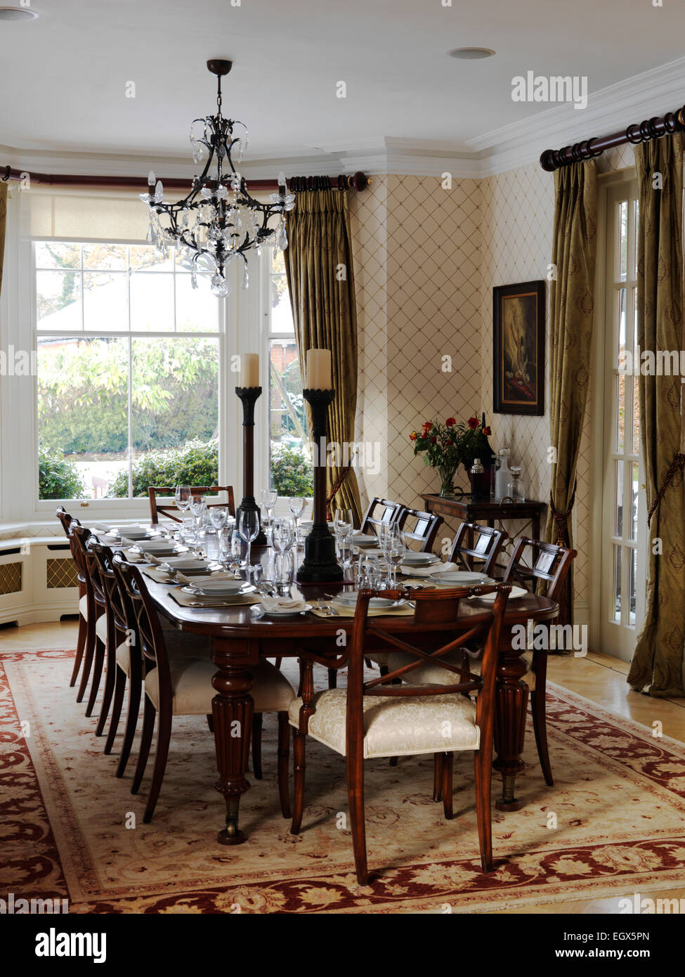 table and chairs in traditional dining room uk home stock