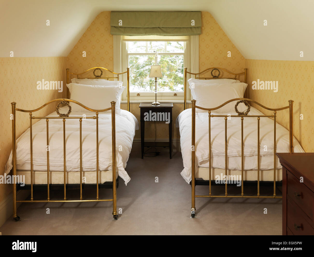 Two brass beds in attic bedroom, UK home Stock Photo: 79251281 - Alamy