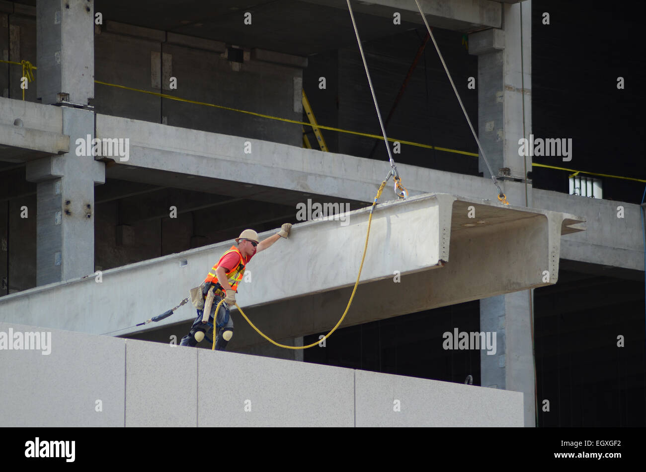 a construction worker guides a structural precast concrete. Black Bedroom Furniture Sets. Home Design Ideas