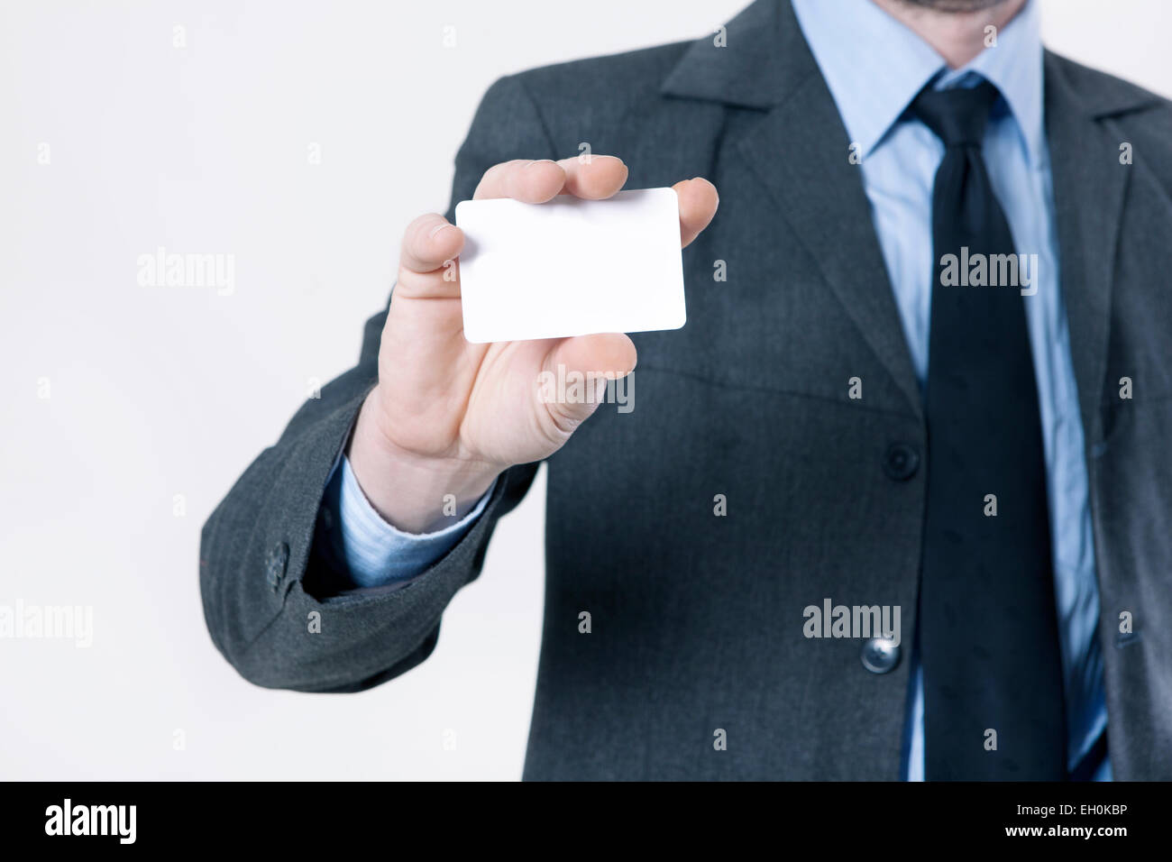 Man in suit and tie holds a white business card in hand no face man in suit and tie holds a white business card in hand no face magicingreecefo Choice Image