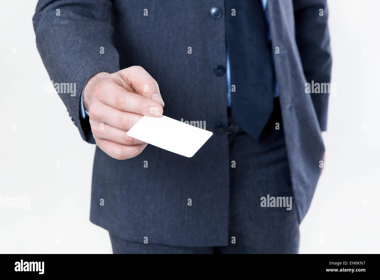 Man in suit with tie holds a white business card in hand no face man in suit with tie holds a white business card in hand no face magicingreecefo Choice Image