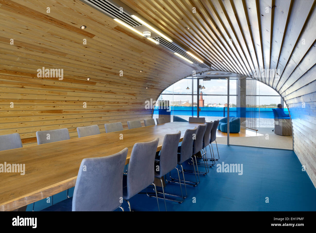 Wood panelled conference room with arched ceiling and blue floor fabrick offices hudson quay