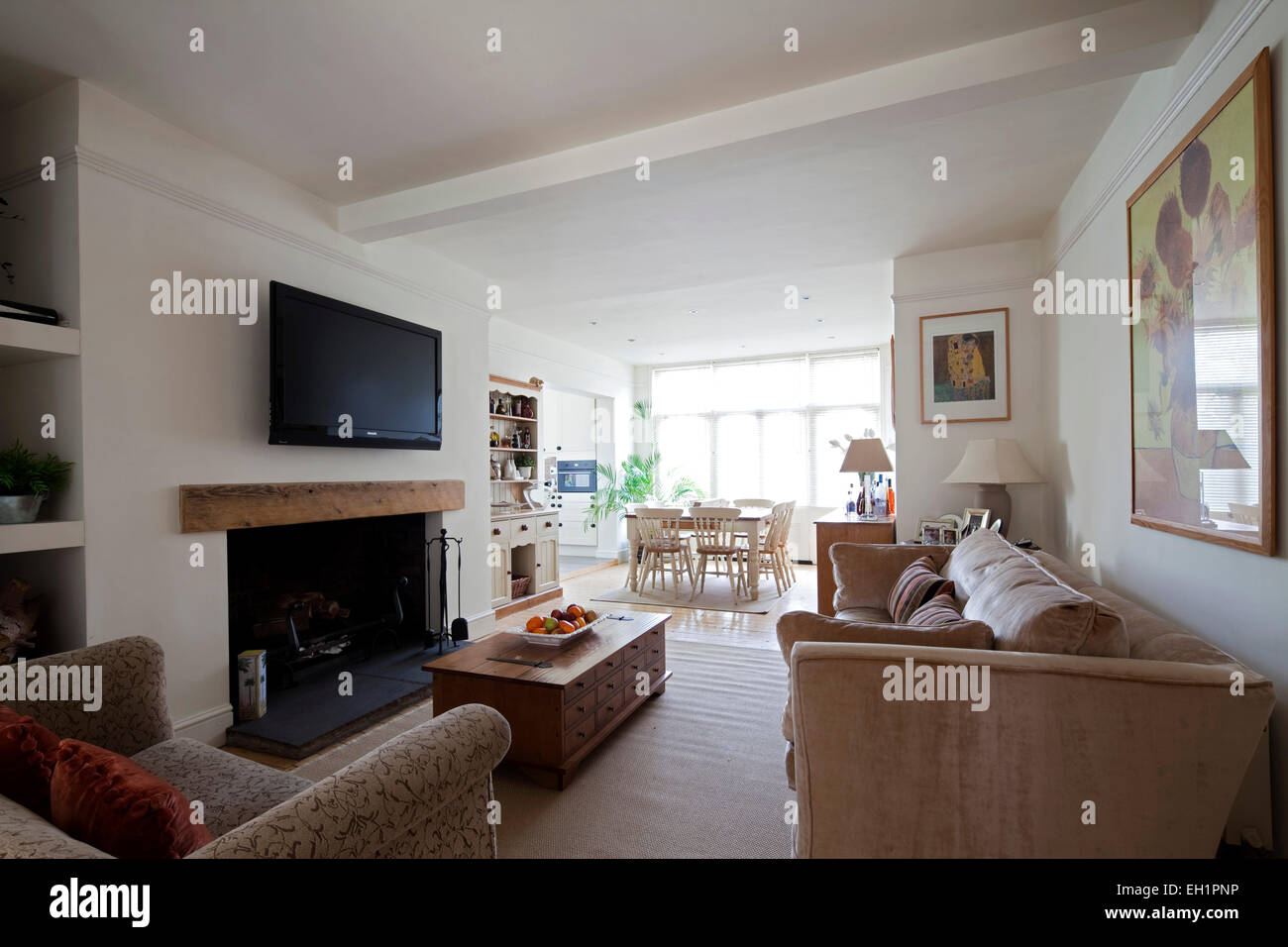 Open Plan Living Room With Plasma Screen Above Fireplace In Macclesfield Townhouse Cheshire England UK