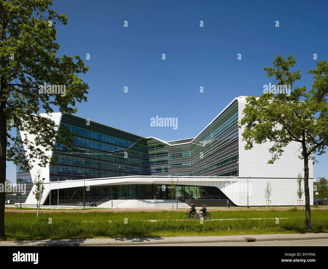 Front Elevation Of Building Part - 45: Overall Front Elevation Of Building Facade With Landscaped Cycle Path.  Astellas Offices - Mirai House, Leiden, Netherlands. Arch