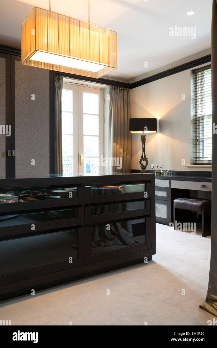 master dressing room suite with built in wardrobes and sitting