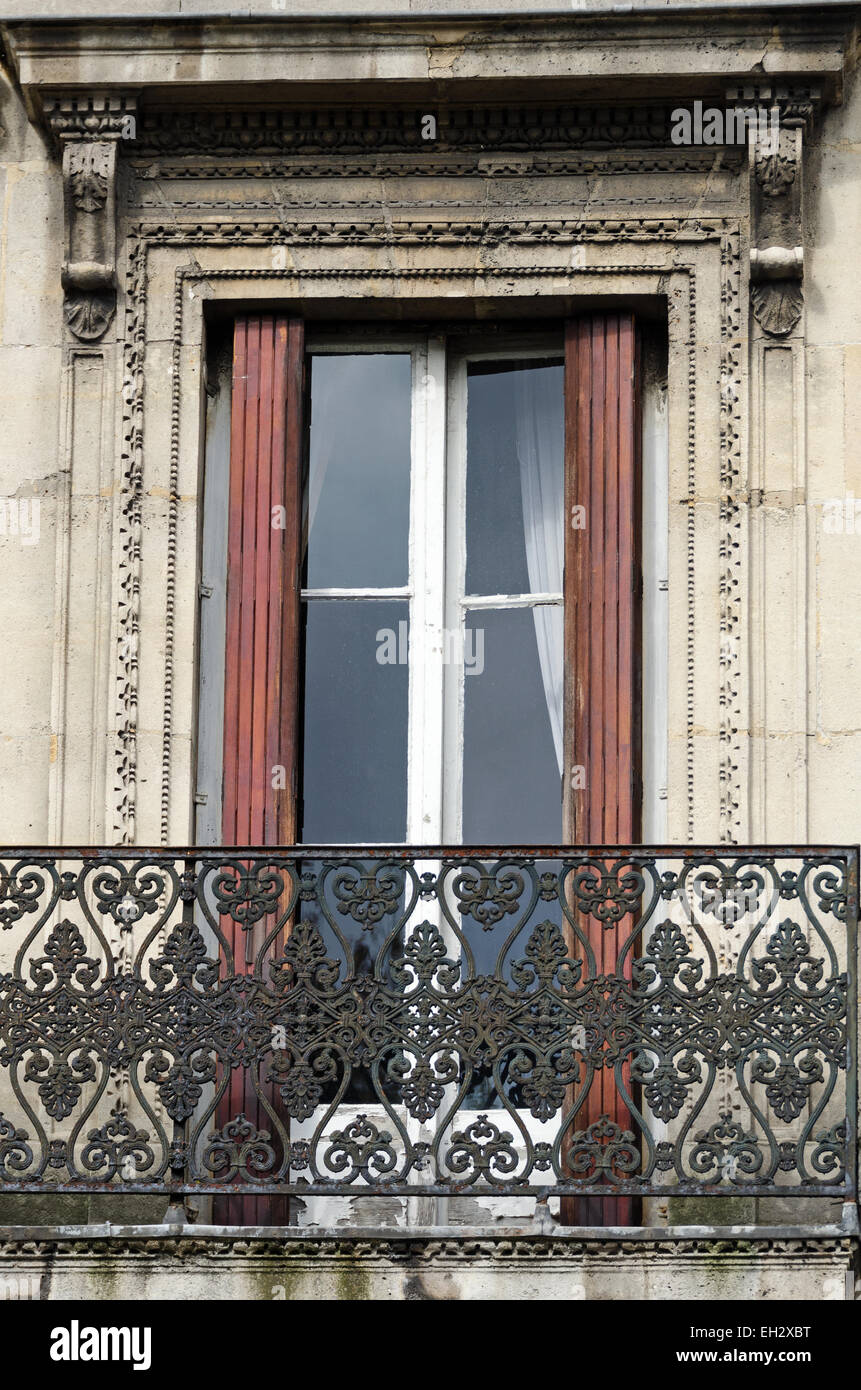 Tall French doors open onto a wrought iron balcony in the Marais Paris France & Tall French doors open onto a wrought iron balcony in the Marais ...