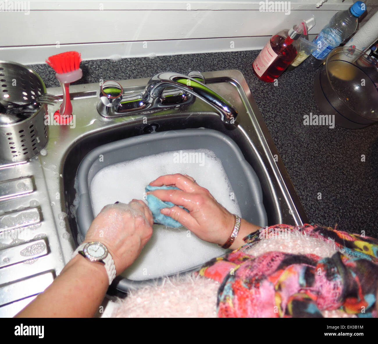 Kitchen Sink With Clean Dishes mature woman washing dishes in plastic bowl in kitchen sink stock