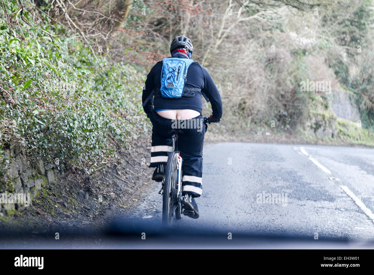 an-overweight-cyclist-showing-his-bum-or