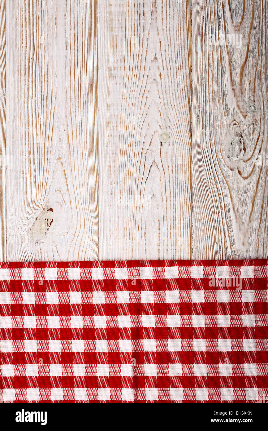 Top View Of Checkered Tablecloth On White Wooden Table