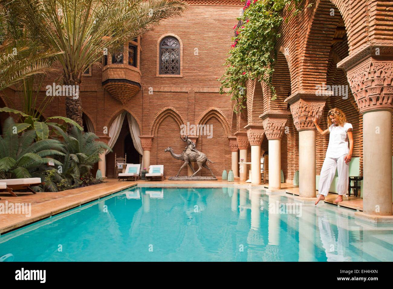 Morocco high atlas marrakech imperial city luxury hotel la sultana 5 stars woman in the pool
