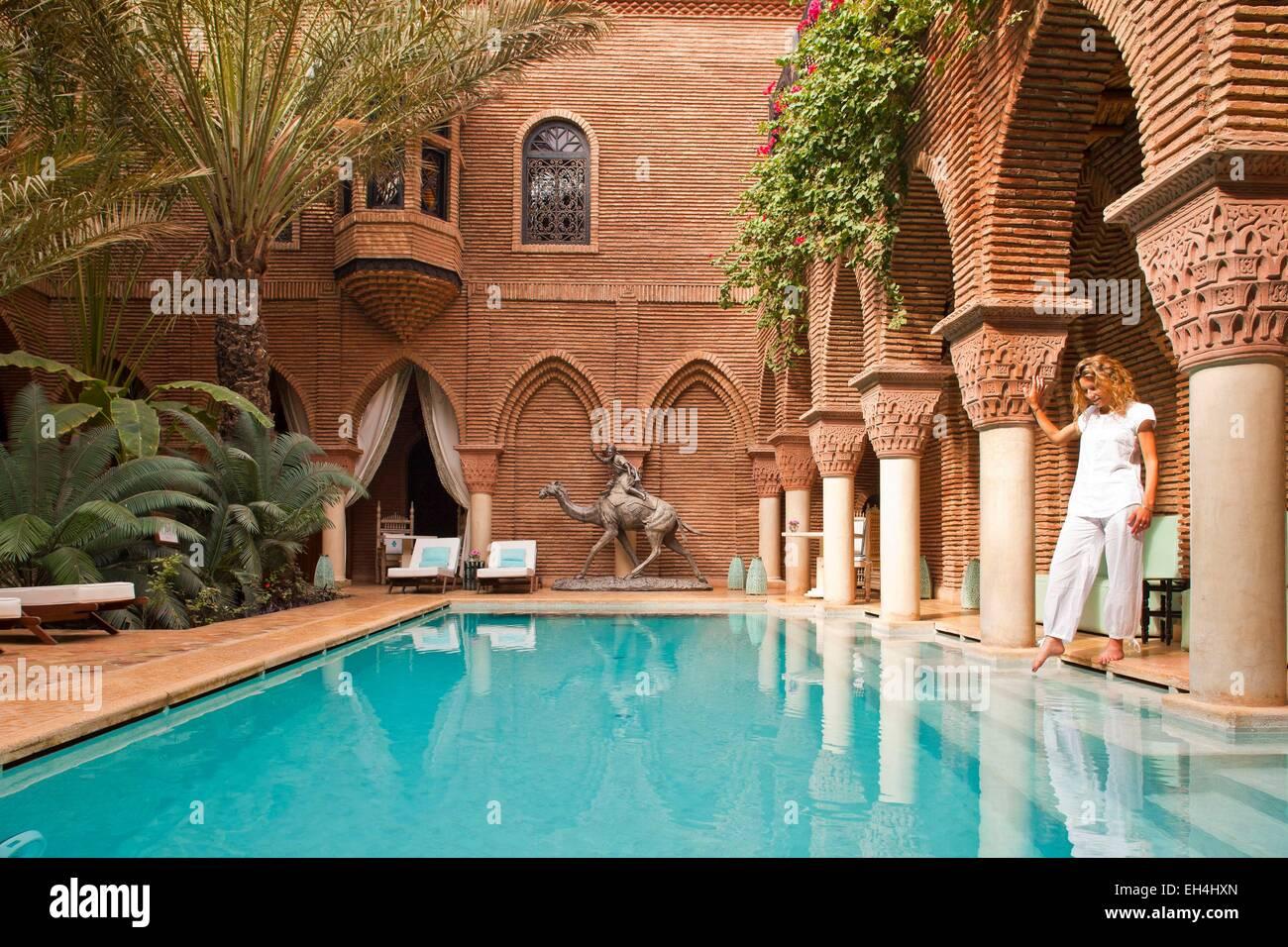 Morocco high atlas marrakech imperial city luxury hotel la sultana 5 stars woman in the pool