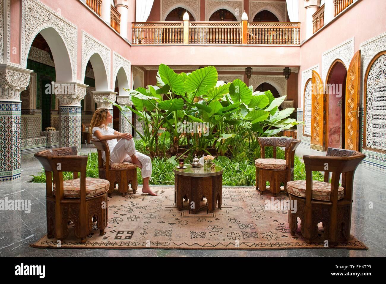 Morocco high atlas marrakech imperial city luxury hotel la sultana 5 stars woman taking a mint tea in an interior room