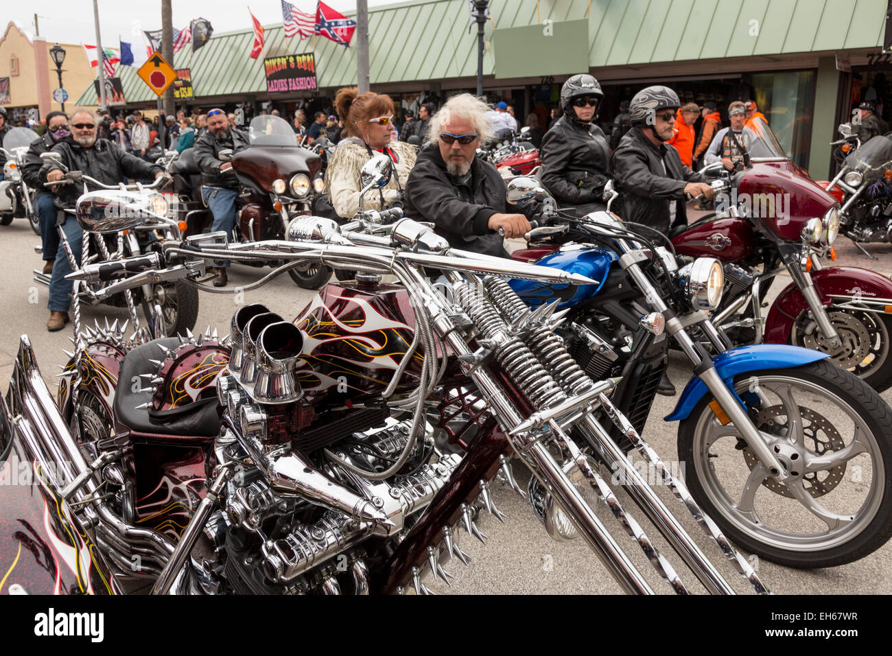 Leather Clad Bikers Ride Down Main Street Past A Customized Stock