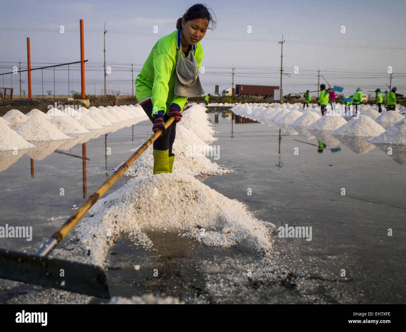 Samut Sakhon Thailand  city photos gallery : Na Khok, Samut Sakhon, Thailand. 9th Mar, 2015. Workers Rake Salt ...
