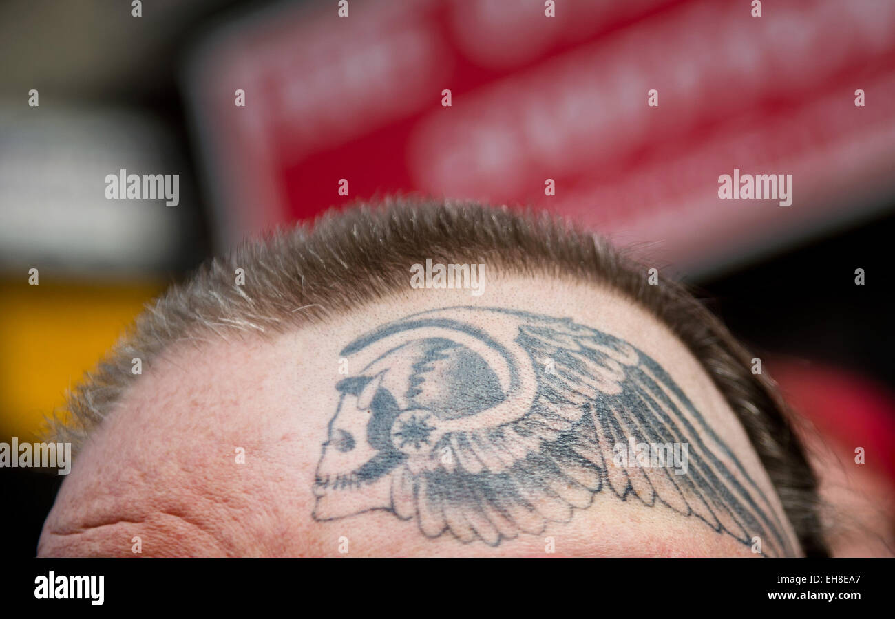 A member of the rocker group 39 hells angels motorcycle club for Hells angels tattoos pics