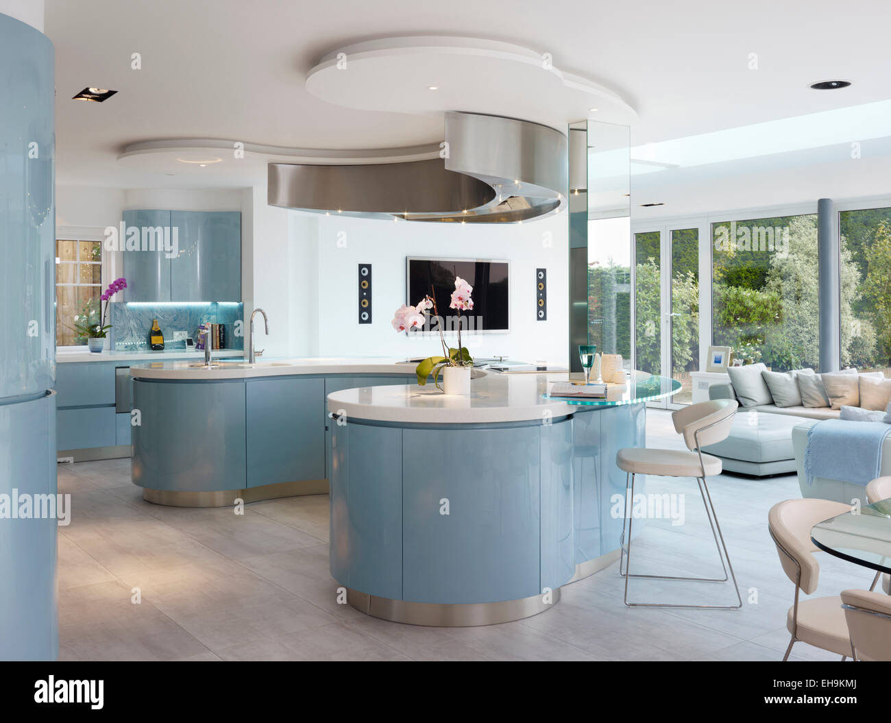 Blue And White Curved Breakfast Bar island In Modern Kitchen Of Stock