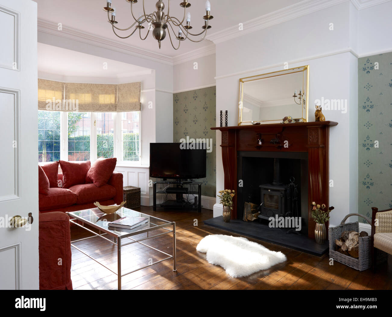 Sitting Room With Bay Window Chandelier And Wood Stove In Fireplace Residential House Kingsmead UK
